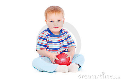 Pretty small boy with red ball