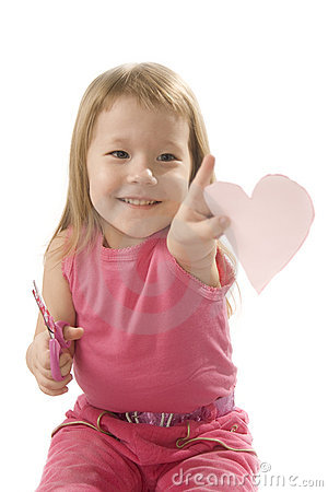 Free Pretty Small Girl Is Cutting Paper Heart Shape Royalty Free Stock Image - 7778886