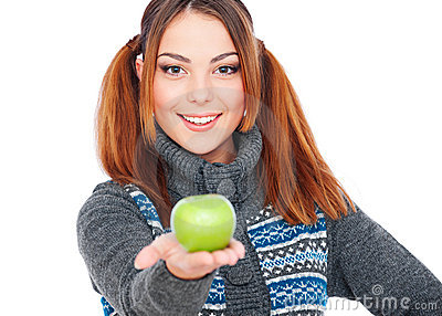 Pretty smiley woman holding green apple