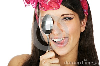 Pretty smilimg girl holding a sppon
