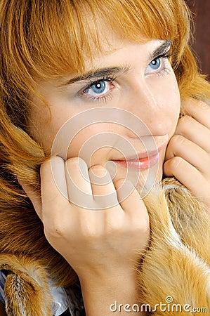 Pretty smiling blue-eyed foxy woman