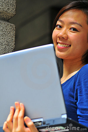 Pretty Smiling Chinese Girl Carrying Notebook