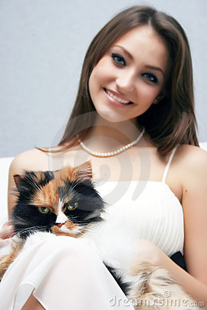 Pretty smiling girl with cat