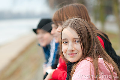 Pretty smiling girl outside with friends