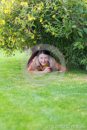 Pretty smiling girl relaxing in the grass