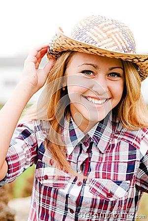 Pretty smiling blond teenage girl in cowboy hat