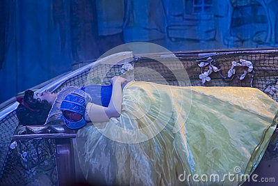 Pretty Snow White Asleep after Biting Apple Editorial Image