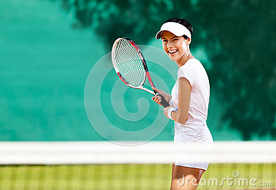 Pretty sportswoman with racquet