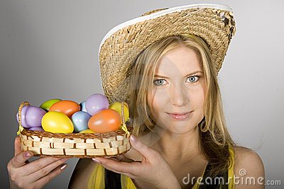 Pretty spring woman with easter eggs