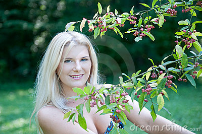 Pretty spring woman  in a green garden near tree