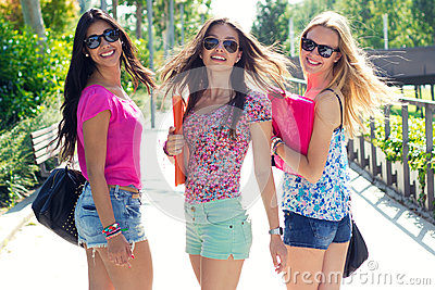 Pretty student girl with some friends after school