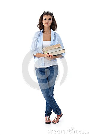 Pretty student holding books