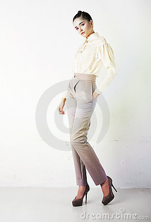 Pretty stylish girl in white trousers and blouse