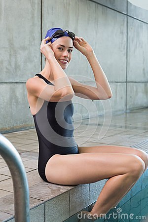 Free Pretty Swimmer Sitting At The Edge Of The Swimming Pool Stock Image - 42542771