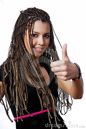 Pretty teen girl showing the thumbs-up sign