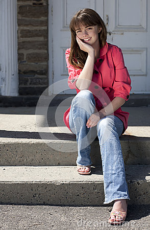 Pretty Teen Girl Sitting on Stairs