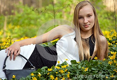 Pretty Teen In Gown Lying In Flowers Stock Photography - Image: 20181912