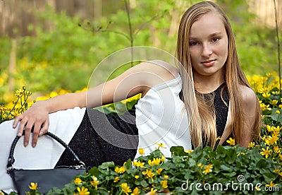 Pretty Teen in Gown Lying in Flowers