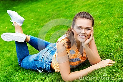 Pretty teen on green grass