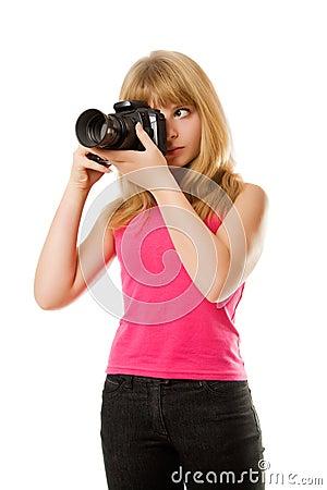 Pretty teenage girl with photo camera