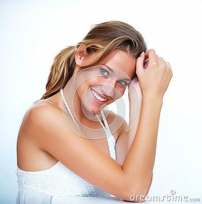 Pretty teenage girl posing against white