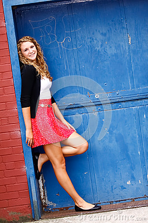 Pretty Teenage Girl Red Skirt Blue Door