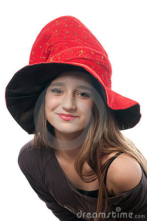 Pretty teenage girl in witches costume