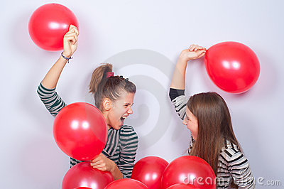 Pretty teenage girls playing with balloons