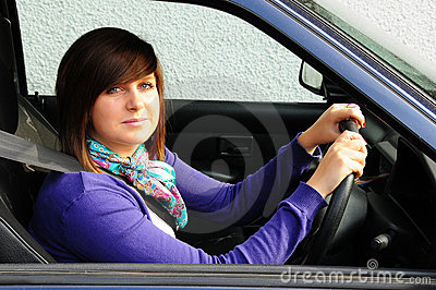 Pretty teenager driving