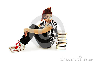 Pretty teenager girl sit on floor and reading book