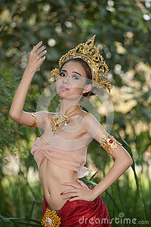 Pretty Thai woman posing in Thai ancient dress .