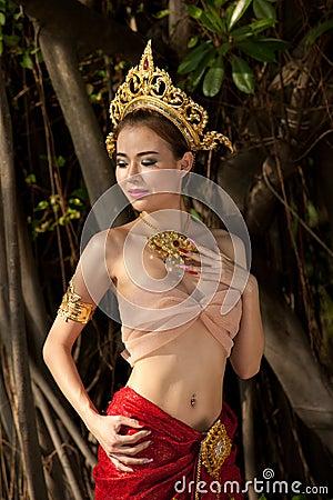 Pretty Thai woman posing in Thai ancient dress .