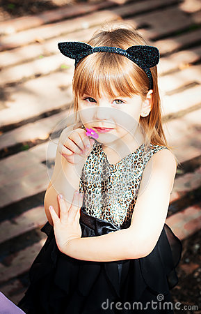 Free Pretty Three Year Old Girl In A Cat Costume, With A Flower In Her Hand. Stock Images - 60604964
