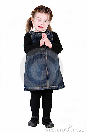 Pretty toddler girl with hands in prayer