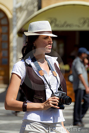 Pretty tourist girl with camera