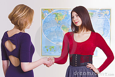 Pretty travel agent greets client