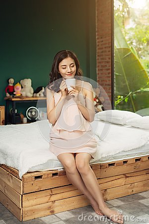 Free Pretty Vietnamese Woman Enjoying Her Morning Coffee At Home Royalty Free Stock Image - 99360826