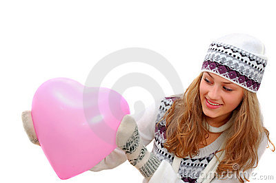 Pretty winter dressed teenage girl with pink heart