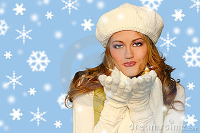 Pretty Winter Girl Blowing Kisses int he Snow