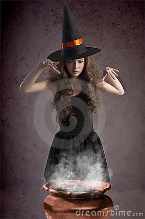 Pretty witch making some spells