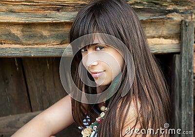 Pretty Woman Against Wood Wall