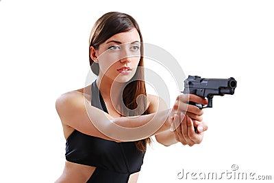 Pretty woman aiming a pistol.