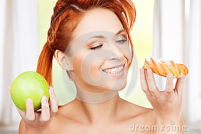 Pretty woman with apple and cake