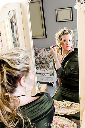 Pretty woman applying makeup