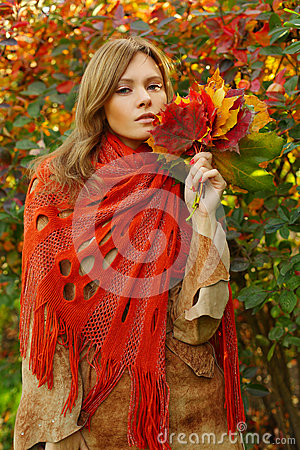 Pretty woman with autumn leaves