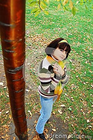 Pretty woman in the autumn park.