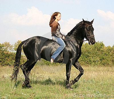 Pretty woman and black horse