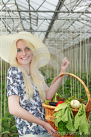 Free Pretty Woman Carrying Basket Of Veggies On Her Arm Stock Photos - 56954573