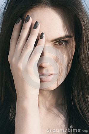Free Pretty Woman Covering Half Face With Hand Stock Image - 62663341