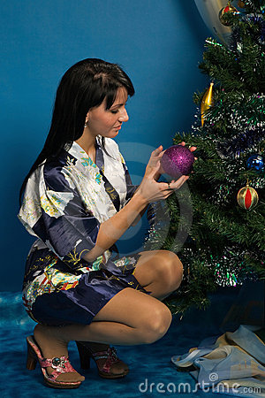 Pretty woman decorate a Christmas tree
